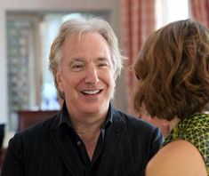 """Alan Rickman laughing with Rebecca Hall at the Venice Film Festival, September 4, 2013. She was in """"A Promise"""" with him   via Mike Ebersol"""