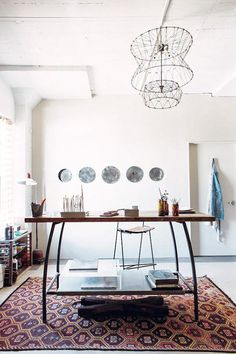 A fantastic fixture and desk from emily quinton's maker spaces book, via french by design / sfgirlbybay