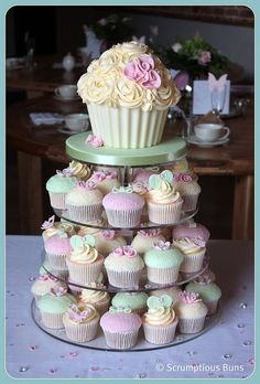 I love this idea, then use the top cupcake as the smash cake.