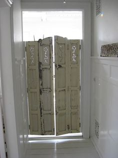 DIY:  Salvaged shutters replace a standard door.  This is so creative!
