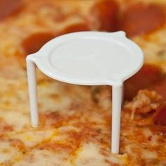 PIZZA CHEESE PROTECTOR - back when pizzas came in paper bags/boxes these little devices stopped the cheese sticking to the bag. For some strange reason I collected them.