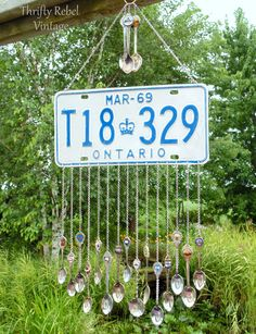 How to make a fun license plate wind chime with repurposed souvenir spoons as the chimes.