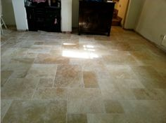 The Light Tumbled Travertine tiles, laid by a local tiler.