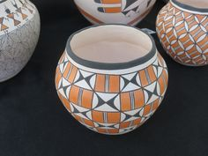 https://flic.kr/p/qYaoHr   Traditional Acoma Pottery, Carefree, Arizona Indian Market, January 2015.   Traditional Acoma pottery is highly prized The clay is hand rolled producing a thin walled vessel, almost always covered with a white glaze and then decorated with designs using natural dyes available on the reservation.