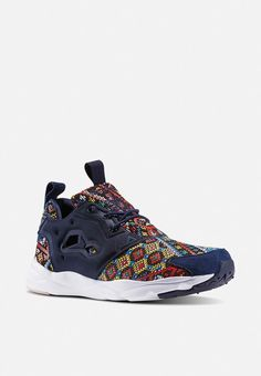 Combining a retro African-style print with bold colours and various textures, these kicks will put a fresh-to-death spin on just about any look. Featuring a mesh upper, perforated detail on the sides anda EVA midsole for cushion and shock absorption, these sneakers will make a killer addition to your closet whether you decide to wear them to the bar, the basketball court of a day spent shopping. Pair yours with rolled-up skinny jeans and a slim-fitting tee. African Style, African Fashion, Bold Colors, Colours, High Top Sneakers, Sneakers Nike, Dusty Pink, Spin, Reebok