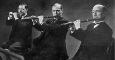 The flute section of the London Symphony Orchestra on the set of the film 'Instruments of the Orchestra' in The first flute on the right is Gordon Walker, with his son Edward 'Eddie' Walker playing piccolo. The second flute is not known. Instruments Of The Orchestra, Wooden Flute, London Symphony Orchestra, History, Film, Musicians, Scrapbook, Costumes, Education