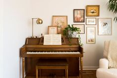The piano is a point of pride in their home; the couple found it on Facebook Marketplace. Jordana loves when Trent plays in the evening. The gallery wall is made up of vintage pieces and thrifted items along with artwork purchased from Minted (the portrait of the woman).