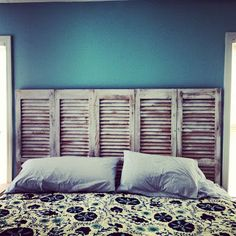 Southern Happy Hour   DIY head board out of old shutters. And you can hang bundles of dried flowers and small wreaths with pretty ribbon tied through the slats!