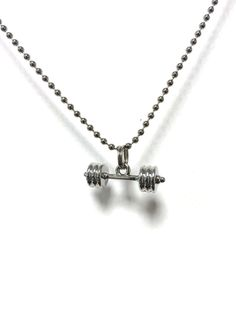 Barbell necklace you or a friend will love. Look awesome while you get strong!