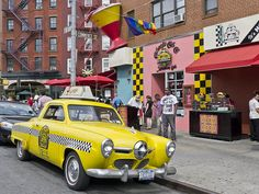 "Vintage taxi outside Caliente Cab Company, a festive Mexican restaurant on Bleecker Street. License plate reads ""TACOTAXI"" Taco Taxi by Joel Raskin, via Flickr"