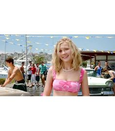 @Who What Wear - Movie: Bring It On  Year: 2000  Character: Torrance Shipman  Why We Love It: The puka shell necklace says it all!     Get The Look: Anthropologie Beechbone Strand Necklace ($48)