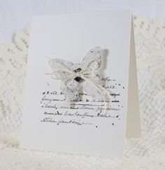 CAS die cut butterfly. Sparkly heat embossed. Script stamp under it.