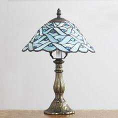 Beautiful Tiffany style lamp with scalloped glass shade.
