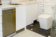 An inner city Sydney apartment with a toilet and shower in the kitchen will set you back $350 a week rent.
