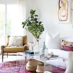Bohemian living room, pops of pink, leather antrho cahir, vintage baskets, lightblue accents