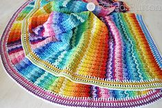 Illuminations Blanket from Felted Button  This colorful and vibrant blanket is sure to make you smile on even the dreariest of days . FREE crochet afghan pattern! Get the link to this pattern and more at Hookin' on Hump Day. #crochet #fiber