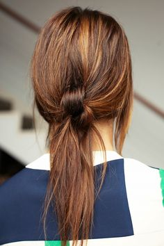 The double-knotted ponytail is a chic alternative to the traditional low ponytail