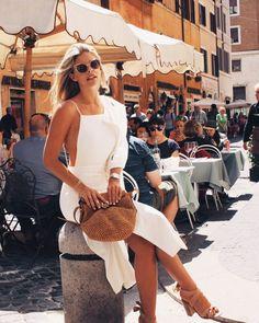 Natasha Oakley in a white dress by Revolve