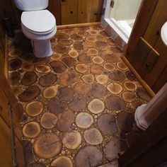 Chicago flooring company Birger Juell Ltd., this bathroom floor comprises horizontal cuts of oak, birch, and maple, as well as tiny twigs and branches gathered from the client's property. DIY Flooring - Bob Vila