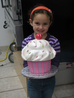 Emma with cuppy cake - considering she is approaching my height now and here this cupcake looks massive with her. www.toonicetoslice.ca.  I think she was in JK here... now in grade 4! AHHH!