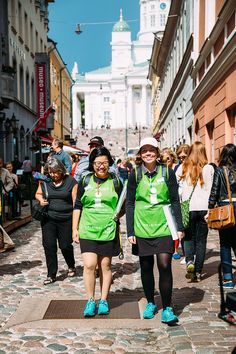 (c) Jussi Hellsten. 27.8.2014. The Helsinki Helpers, who are easily identified by their green vests, patrol the inner city and cruise harbours in the summer from June until the end of August. Helsinki, Finland