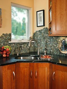 Eye Candy: 11 Totally Unique DIY Kitchen Backsplash Ideas...............My favorite is the river stone backsplash!!