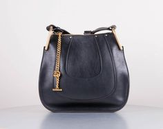 Details:  Details:  100% leather  color black  zip closure  long leather shoulder strap  STYLE WITH
