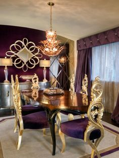 The deep purple upholstery and window treatments, accented with metallic gold, make this dining room fit for royalty.