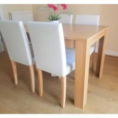 17 Stories This dining set made of oak effect and comes with 4 cream chairs. Table material: MDF with a laminate finish, it comes flat packed and needs simple home assembly, all the tools and fittings are included in the package. Cream Dining Chairs, Dining Set, Dining Table, Simple House, Console Table, Free Delivery, Things To Come, Interior, Tools