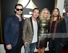 Musicians Tomo Milicevic and Shannon Leto of 30 Seconds to Mars, singer Rita Ora and musician/actor Jared Leto of 30 Seconds to Mars attend the 56th GRAMMY Awards at Staples Center on January 26, 2014 in Los Angeles, California.