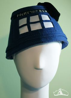 Dr. Who's Tardis inspired fez hat for either men or women. Gorgeous blue wool in the traditional fez shape. Features hand-stitching to create the iconic Tardis. Great for a Dr. Who party or for collec