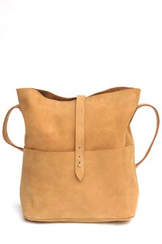 The Nubuck Messenger by Meyelo is handcrafted with premium soft nubuck leather by local artisans in Kenya. Each bag has an authentic feel with a simple, elegant, rugged design. Shades of leather may v