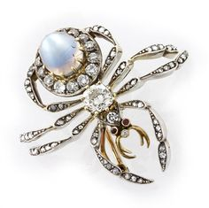 A VICTORIAN MOONSTONE AND DIAMOND SPIDER BROOCH - Bentley & Skinner