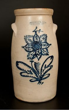 "4 Gal. JOHN BURGER / ROCHESTER Stoneware Churn, C. 1860.  Semi-ovoid, tooled shoulder, flared collar, applied lug handles & a visually-striking slip-trailed design. Flowering plant with alternating oval & radiating petals. Cross-hatched center. Outstanding color. Spidering sealed cracks. Filled 1 1/4"" x 1"" rim chip on side. Two other small filled rim chips. Typical wear on interior rim. Chip to one handle. Minor unobtrusive fry to cobalt.  Crocker Farm. 3/1/14. Lot #103.  Est: $500-$700."