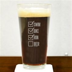Our Swim Bike Run Checklist Pint Glass is the perfect glass to raise to celebrate a huge triathlon finish. This 20 oz pint glass engraved with one of our exclusive and popular triathlon designs makes a perfect gift for a triathlete.