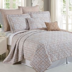 The Austin Geo bedspread set is a very mellow 7 piece bed set that is a traditional modern design.Very light beige and taupe color schemes with a square overlapping pattern makes this a sophisticated and eye-catching centerpiece. Made of super soft and durable microfiber polyester these covers are easy to care for and will last a life time with proper care. This whole masterpiece bed set comes with a standard sized coverlet, 2 pillow shams, 2 euro shams and 2 different sized throw pillows to…