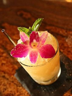 Photo by: Circa Restaurant, Los Angeles Maita'I Roa Ae! (Mai Tai)  Created by Julian Cox 1 oz Appleton 12-Year rum  1 oz JM Rhum  0.75 oz lime  0.5 oz orgeat (almond syrup)  0.5 oz orange curaçao  0.25 oz Smith and Cross over-proofed rum  Powdered sugar  Garnishes: edible orchid, mint sprig Build in glass with crushed ice. Stir and top with more crushed ice. Top with an edible orchid and mint spring. Lightly dust with powdered sugar. On draft at Circa.