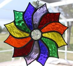 Rainbow coloured pinwheel suncatcher