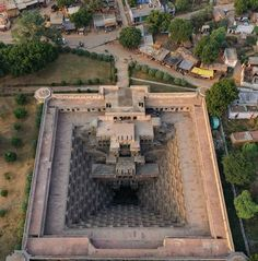 An aerial view of Chand Baori. It extends approximately 30 m ft) into the ground making it one of the deepest and largest stepwells in India. Architecture Antique, Indian Temple Architecture, Ancient Greek Architecture, Beautiful Architecture, Art And Architecture, Amazing India, Grand Mosque, Rajasthan India, London City