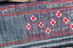 Length - 17 ft 9 ; 5.40m Width - 11 1/2 ; 29cm Weight - 640g  Genuine Vintage Hmong batik and applique hemp fabric. All hand woven and hand stitched!  The inspiration for these batik motifs are derived from the natural environment, and are made with the wax relief method with a natural indigo dye obtained from a flower grown on the edges of the rice terraces.  Decorated with beautiful hand embroidery of silk thread and hand stitched applique. This single piece would have taken several weeks…