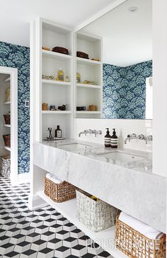 Large baskets are an inexpensive way to remedy a lack of storage. | Photographer: Valerie Wilcox | Designer: Kai Ethier