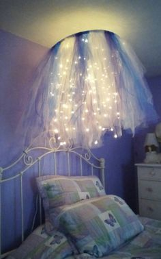 Hula hoop chandelier I made for my daughter's room, 2 shades of purple and teal to compliment the room.