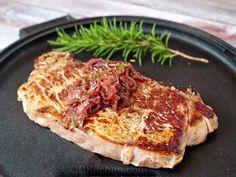 Made with vegetable oil, red onions, salt and pepper, strip steaks, garlic, balsamic vinegar, fresh rosemary, brown sugar | CDKitchen.com