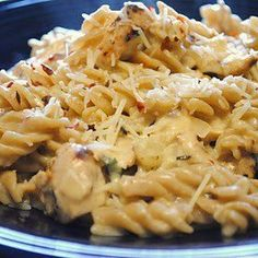 Crockpot Italian Chicken 4 	chicken breasts 1 	packet Zesty Italian dressing seasoning 1 	8 oz. cream cheese (softened) 2 	cans cream of chicken soup  Serve over pasta.