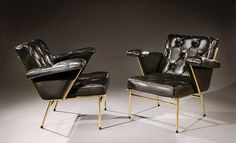 MATHIEU MATEGOT (1910-2001) -  Pair of armchairs with straight, inclining backrests and filled fin shaped armrests on a gilded brass tubular structure. Upholstered in black padded leather.