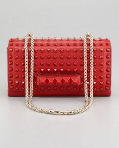 signature Valentino red + iconic pyramid studs + practical size