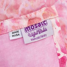 Adult weighted blanket in a feminine pink color palette; made with batik, cotton material. See our full line of adult womens weighted blankets. Get safe, effective, non-toxic natural relief with our weighted blankets.