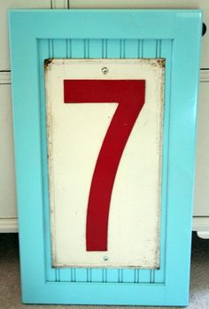 Fun Play room Decor using an old cabinet front and a vintage gas station number.