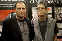 The U.S. singer Lou Reed, poses accompanied by the illustrator Lorenzo Mattotti, during the presentation of the book set in Barcelona 'The Raven'..