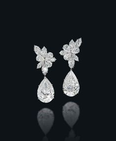 A pair of diamond earrings, by Harry Winston #christiesjewels